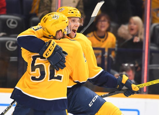 Nashville Predators center Nick Bonino (13) celebrates with defenseman Matt Irwin (52) after scoring a hat trick goal against the Chicago Blackhawks during the third period on Tuesday.