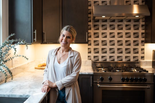 Allie Farrell stands in her renovated kitchen in her home near downtown Nashville.