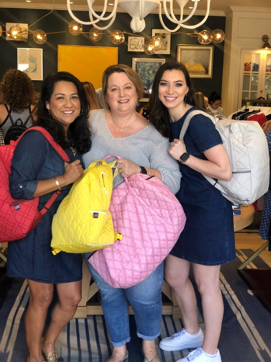 Cara Finger (middle) stands with supporters (left) Trish Elam of Pandy Cotton Candy and Presley Russell of Draper James, at the launch last week of her new nonprofit My Bag My Story at Draper James in Nashville.