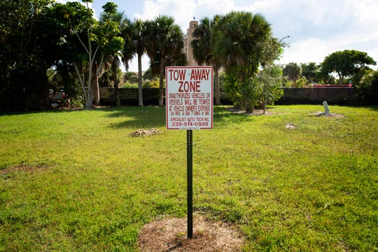 A parking sign is pictured on a piece of land owned by Stock Development, Thursday, Oct. 24, 2019, in North Naples. The site is the future home of Stock Development's One Naples luxury condo project.
