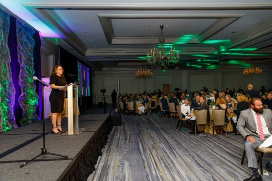 Angela Fisher, president and CEO of Junior Achievement in Southwest Florida, takes the microphone at the 2019 Business Hall of Fame event.