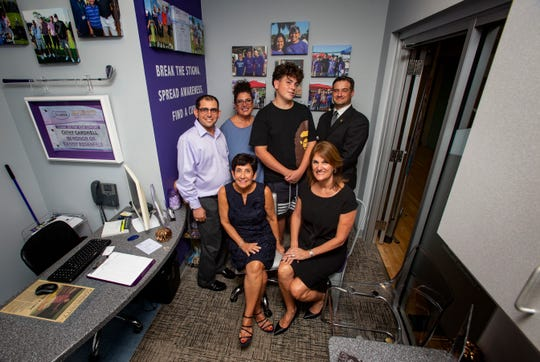 Epilepsy Florida members, Danny Rosenfeld, from top left, Maryanne Garcia her son Antonio Garcia, board member Bryan Filson, Lizzie Golumbic, seated left, and Tamara Wolfe, pose for a portrait, Tuesday, Oct. 29, 2019, at Naples Epilepsy Resource Center located inside the Greater Naples YMCA in North Naples.