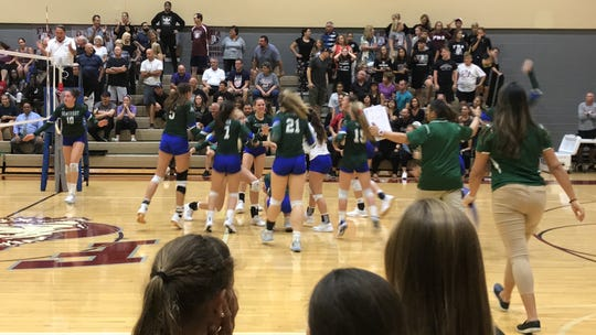 Seacrest Country Day celebrates a thrilling four-set win over First Baptist Academy in the Class 2A-Region 3 semifinal Tuesday at First Baptist. The Stingrays won 25-23, 21-25, 25-22, 27-25.