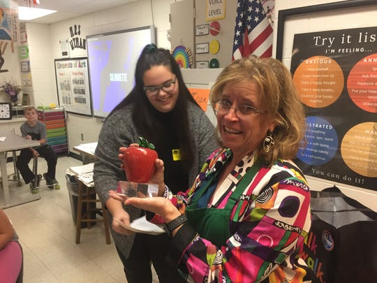 Jodi Wyman (right) receives her award from Alexia Rose of the Licking County Foundation during a surprise presentation in her Etna Elementary classroom on Oct. 30.