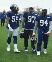 New York Giants defensive linemen Leonard Williams (99), Dexter Lawrence (97) and Dalvin Tomlinson (94) share a laugh as they leave the practice field Wednesday in East Rutherford, NJ. This was Williams' first practice with the Giants since being acquired from the Jets via trade.