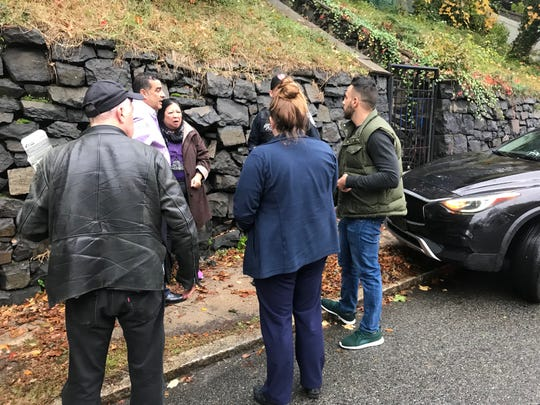 Group of people rescued a woman who flipped her car in Edgewater, pulling the driver to safety.