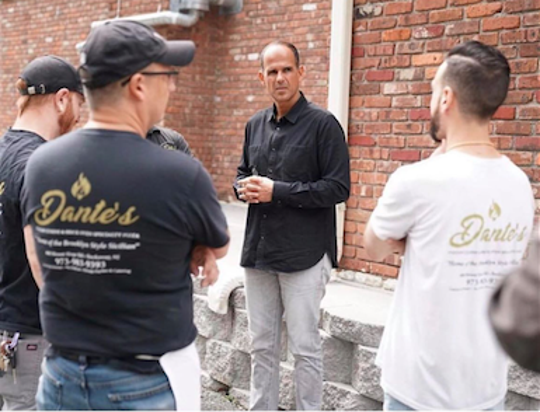 """Dante's Italian Cuisine will be featured on season seven of """"The Profit,"""" which stars Marcus Lemonis (center)."""