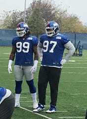 NY Giants defensive linemen Leonard Williams (99) and Dexter Lawrence (97) go through drills Wednesday morning. This was the first practice for Williams since being acquired via trade from the Jets.