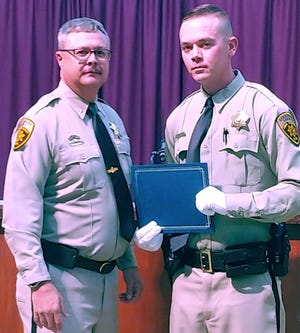 Luna County Sheriff Kelly Gannaway, left, welcomes Patrol Deputy Dylan Graves to the Luna County Sheriff's Office.