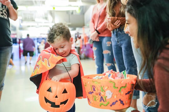 Children trick or treat at a Halloween Hoops  event at the Pan American Center in Las Cruces on Tuesday, Oct. 29, 2019.