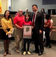 Left: Christina Lilley, Art teacher at Picacho Middle School, Bill Hawkins, Chair, Veterans Day Parade Committee, Evanee Stockman, winner of the Veterans Day Parade Poster, and Mayor Ken Miyagishima