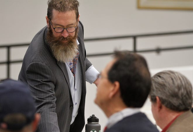 Convener Jason Sandel of Farmington, seen here greeting members of the Energy Transition Act committee at San Juan College in 2019, is now chair of a business organization that seeks to boost exports of Rocky Mountain region natural gas.