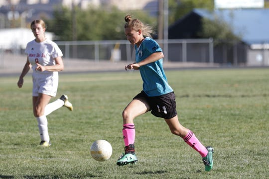 Navajo Prep's Emma Mohs goes on the attack against Monte Del Sol during a District 1-A/3A girls soccer match on Thursday, Oct. 17 at Eagle Stadium in Farmington.