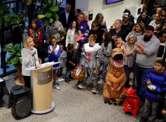 Gayle Dean, left, executive director of the San Juan College Foundation, talks about the new dinosaur exhibition at the Sherman Dugan Museum of Geology on Oct. 29, 2019, before the display is unveiled.