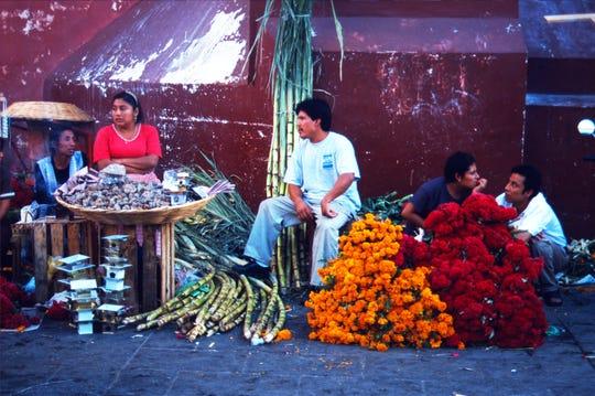 October brings copal, flowers and sugarcane into the markets of Mexico for El Dia De Los Muertos.