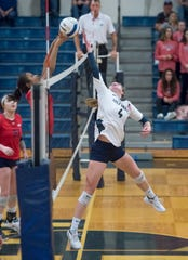 Anna Marks (4) leaps to block the ball during the Wakulla vs. Gulf Breeze playoff volleyball match at Gulf Breeze High School on Tuesday, Oct. 29, 2019.