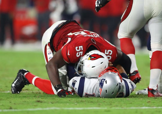 Arizona Cardinals linebacker Chandler Jones (55) sacks New England Patriots quarterback Jimmy Garoppolo in the fourth quarter at University of Phoenix Stadium. The Patriots defeated the Cardinals 23-21.