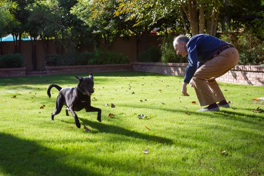 """Clive Wynne, director of the Canine Science Collaboratory at ASU and author of """"Dog is Love,"""" plays with his dog Xephos, Oct. 29, 2019."""