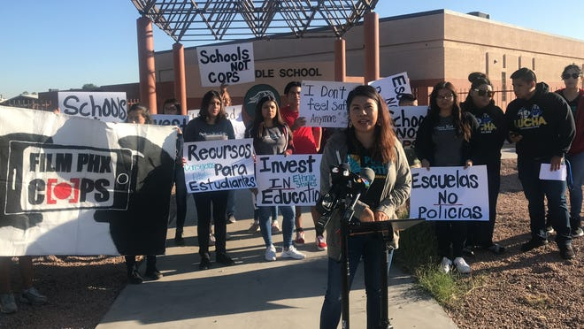 Viri Hernandez addresses the media outside of Isaac Middle School in Phoenix on Tuesday, Oct. 29, 2019.