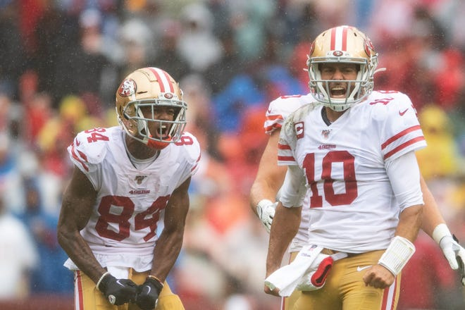 Quarterback Jimmy Garoppolo (10) and receiver Kendrick Bourne (84) reacts getting a first down during a game against the Redskins at FedExField.