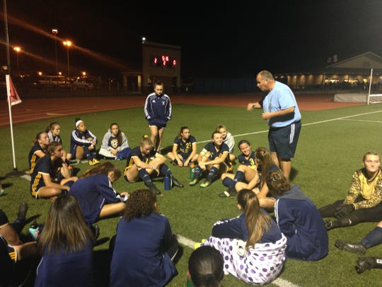 Elco head coach Derek Fulk urges his squad on at halftime of the Raiders' 2-0 district semifinal win vs. Lancaster Catholic Tuesday night.