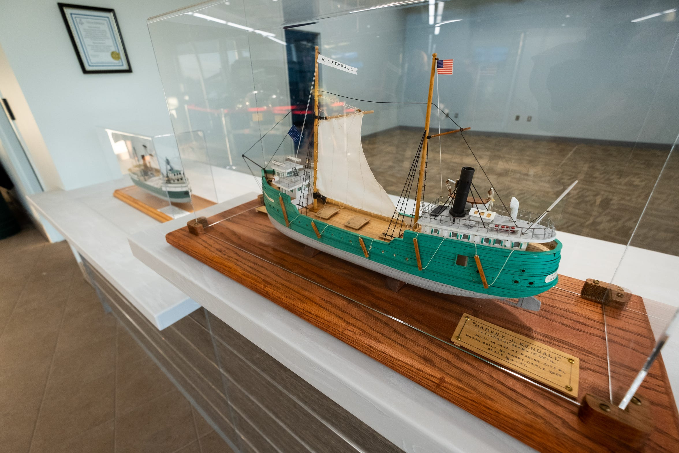 Models of the Harvey J. Kendall and Marysville ships are on the counter in the new Marysville City Hall.