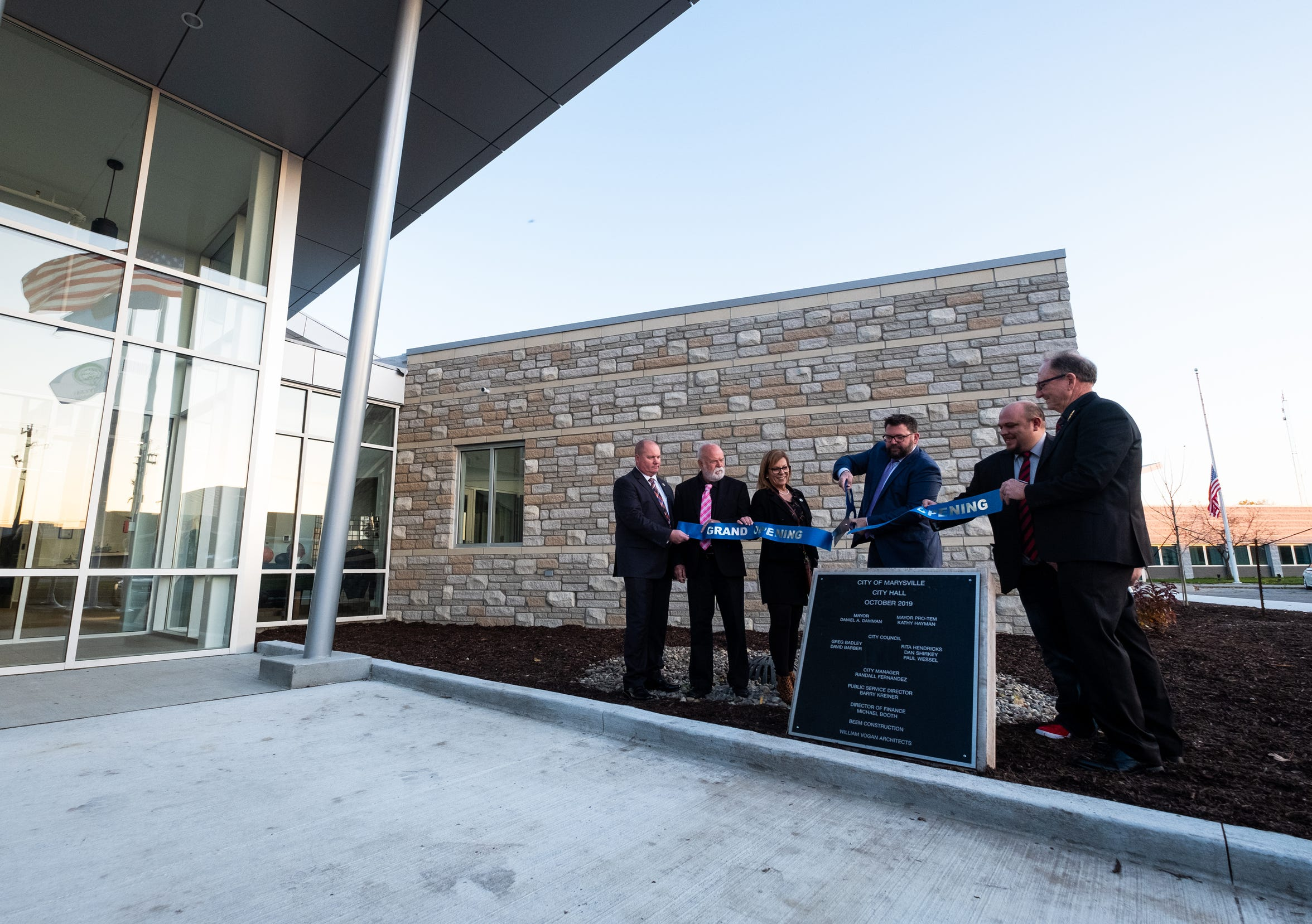 Marysville Mayor Dan Damman, center, participates in a ribbon cutting ceremony with members of the city council for the new city hall Monday, Oct. 28, 2019.