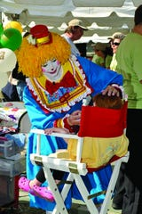Jackie Reynolds does face-painting as Bee Bee the Clown.