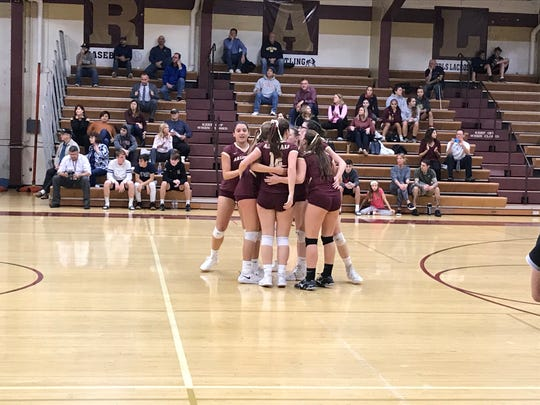 The Arlington High School volleyball team celebrates a a point during Wednesday's match with Mahopac.