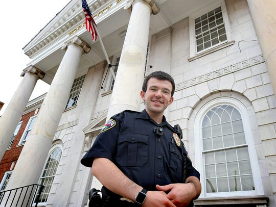 T.J. Platts poses for a photo on the steps of the York City Police Department Wednesday, Oct. 30, 2019. York City's newest police officer, he is the son of former U.S. representative and sitting York County Judge Todd Platts. T.J. was sworn in on Oct. 16. Bill Kalina photo