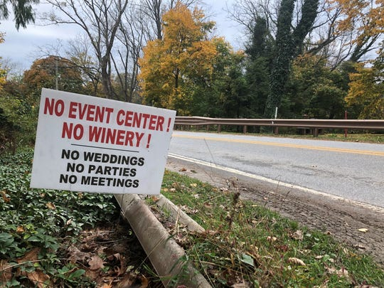A sign opposing a proposed winery and wedding venue in Hellam Township sits along the side of Libhart Mill Road on Tuesday, Oct. 29, 2019.