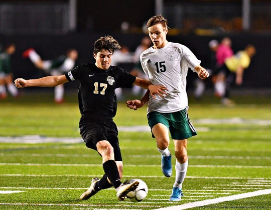 Halifax's Dyson Weaver, left, and York Catholic's Jonathan Yinger battle for control of the ball during District 3, Class 1-A boys' championship soccer action at Hersheypark Stadium in Hershey, Wednesday, Oct. 30, 2019. Halifax would win the game 2-1. Dawn J. Sagert photo