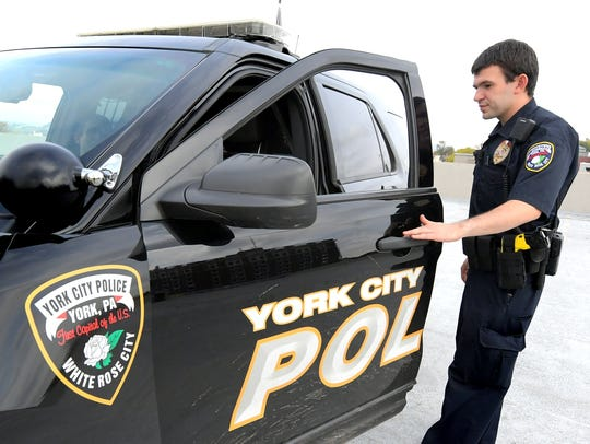 T.J. Platts enters a York City police vehicle during his five-month training period Wednesday, Oct. 30, 2019. York City's newest police officer, he is the son of former U.S. representative and sitting York County Judge Todd Platts. T.J. was sworn in on Oct. 16. Bill Kalina photo