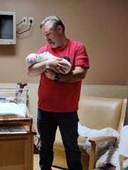 David Noll holds his baby, Emma Jeanne, who at just 1 month old, is being treated for acute myeloid leukemia at Children's Hospital of Philadelphia.