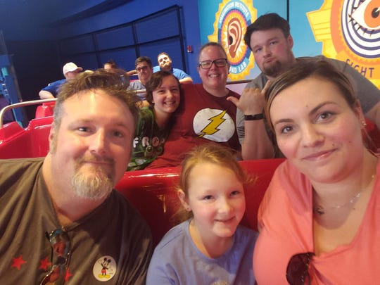On a trip to Disney, David (far left) and Janessa (far right) Noll were just a few months from the birth of their baby girl Emma. Between them is David's youngest daughter, Rachel. Behind them, from left to right, are Sara Noll, her mother, Heather Noll, and Adam Noll, Dave's brother.