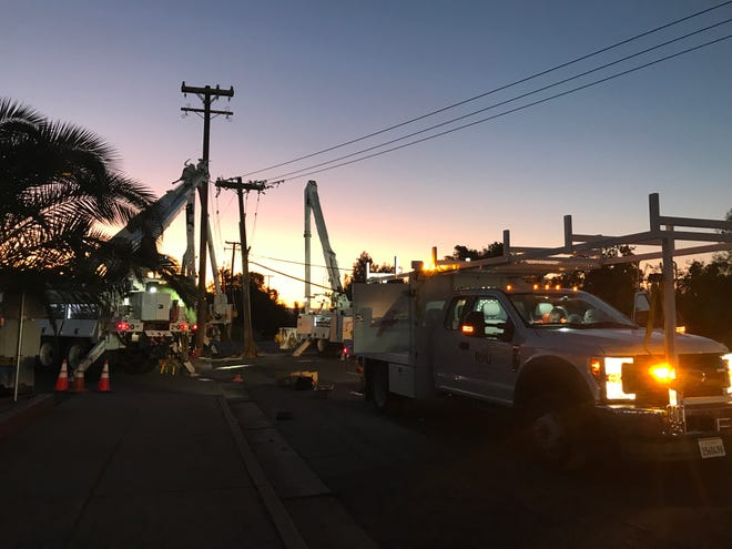 Redding Electric Utility crews repair a power pole that came down early Wednesday morning in the area of Churn Creek and South Bonnyview roads.