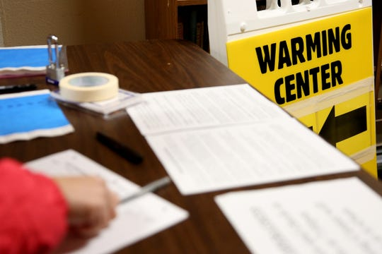 The check-in table at a warming shelter at South Salem Friends Church on Oct. 29, 2019. Tuesday night was the first night this season with overnight temperatures expected to drop below 32 degrees.