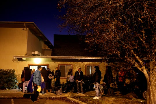 People line up to get inside the warming shelter at South Salem Friends Church on Oct. 29, 2019. Tuesday night was the first night this season with overnight temperatures expected to drop below 32 degrees.