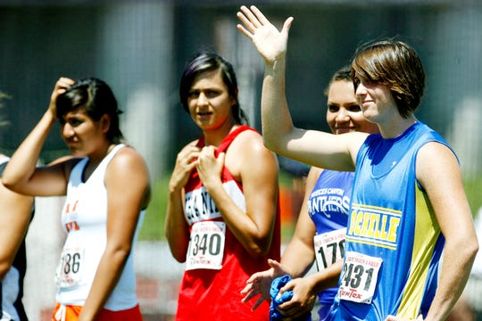 Rochelle High School's Bonnie Richardson waves to the crowd as she is announced prior to the Class 1A girls discus at the 2009 State Track and Field Championships in Austin.