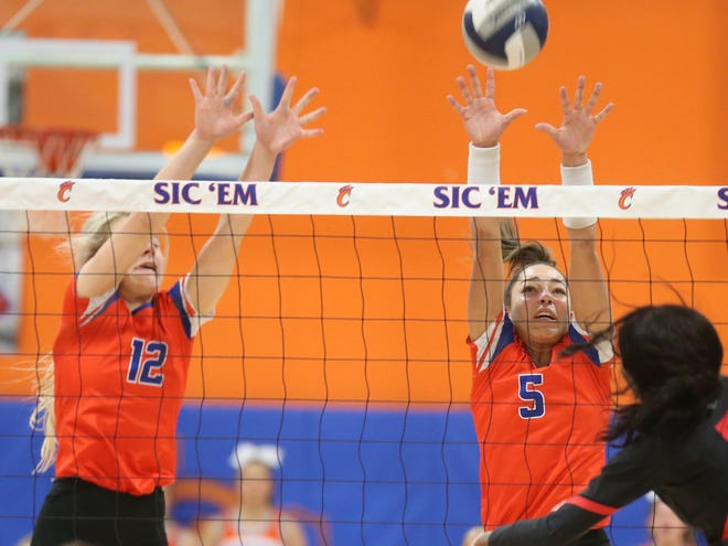 San Angelo Central High School's Presley Knowlton, left, and Mya Moore go up for a block against Euless Trinity during the regular-season finale at Babe Didrikson Gym on Tuesday, Oct 29, 2019. Central won in four sets to finish second in District 3-6A.