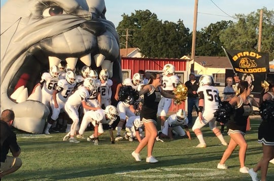 Brady High School football prepares to take the field during a road game in 2019.