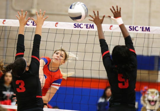 San Angelo Central High School's Nadia Fierro goes for a kill against Euless Trinity during the regular-season finale at Babe Didrikson Gym on Tuesday, Oct 29, 2019.