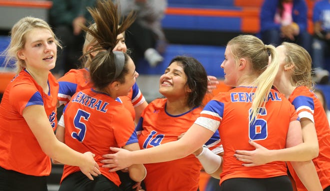 The San Angelo Central High School volleyball celebrates during a four-set victory against Euless Trinity at Babe Didrikson Gym on Tuesday, Oct. 29, 2019. The Lady Cats clinched the runner-up spot in District 3-6A.