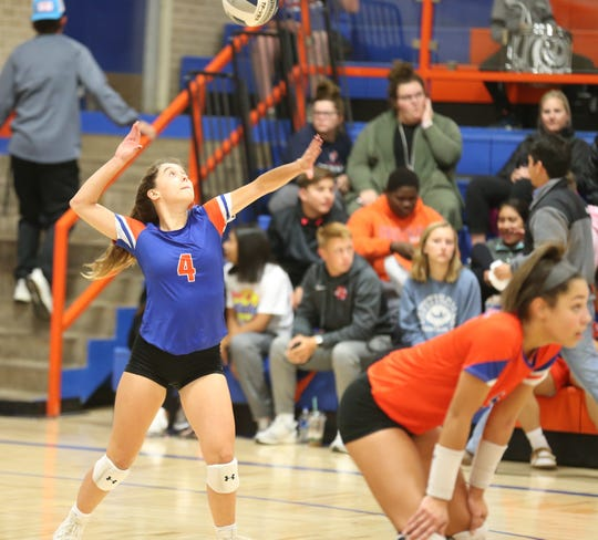 San Angelo Central High School's Caroline Dethloff goes up for a serve against Euless Trinity during the regular-season finale at Babe Didrikson Gym on Tuesday, Oct 29, 2019.