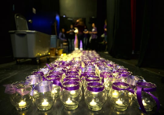 Candles are set up prior to a ceremony honoring victims of domestic violence at the San Angelo Performing Arts Center on Tuesday, Oct. 29, 2019.