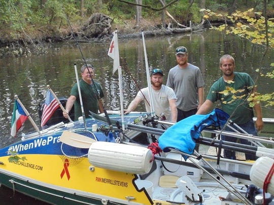 Don Victor Mooney got stuck in the Assawoman Canal during his 5,000 mile journey rowing from the coast of northwest Africa to New York in 2014. Community members, including firefighters, helped remove the logs that were blocking him north.