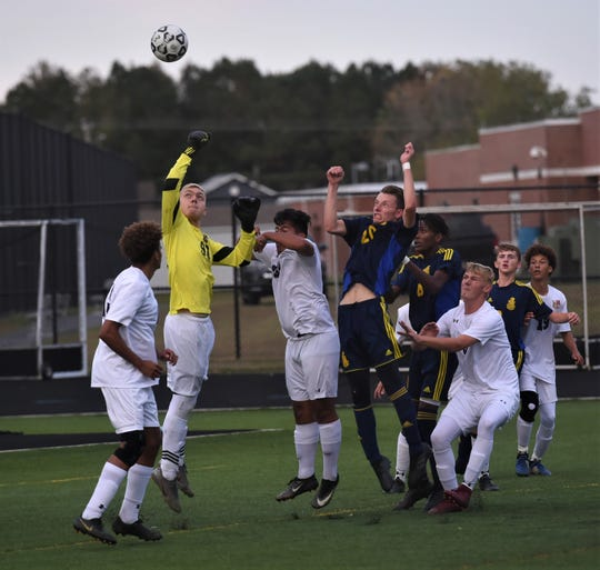 Crisfield keeper Simon Evans goes for the save during the 1A East Regional Championship on Tuesday, Oct. 29, 2019.