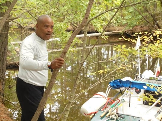 Don Victor Mooney got stuck in the Assawoman Canal during his 5,000 mile journey rowing from the coast of northwest Africa to New York in 2014. Community members, including firefighters, helped remove the logs that blocked his path north.