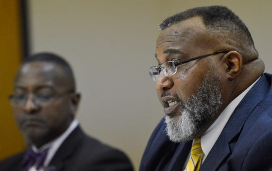 Rep. Cedric Glover, front, speaks during a round table meeting on Wednesday, Oct. 30, 2019. Rep. Patrick Jefferson, back, listens.