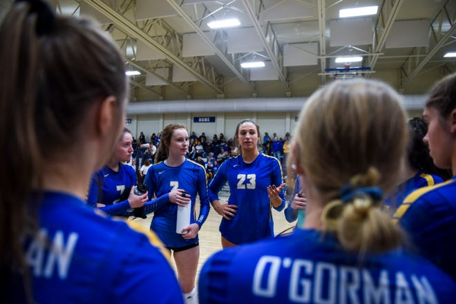 O'Gorman's Emma Ronsiek speaks to her teammates in a time out during a match against Washington on Tuesday, Oct. 29, 2019 at O'Gorman High School.